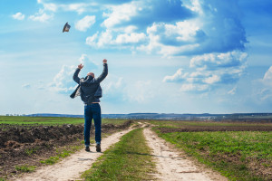 man walks along a dirt road and enjoy the freedom.